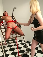 Cowgirl doms Ivy, tied to steel rack, caned, vibrator play.