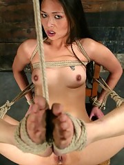 Asian babe is tied up and tormented with electro shocks