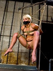 Tan, oiled, blond gets bound fucked and made to cum!